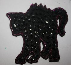 Sequin black cat. Can be put on a clip to be worn in your hair/ on a headband, or a pinback to wear on clothing/purse to spice up your Halloween wardrobe. $5.00 each