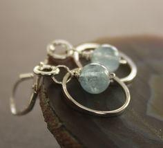 Pale blue aquamarine sterling silver earrings on hammered hoops - Aquamarine earrings - Hoop earrings - Dangle earrings. $27.00, via Etsy.