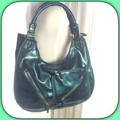 Patent Dark Green Bag Beautiful dark green patent hobo bag with top zipper closure!  Zip detail around the outside. Three zip outside pockets and three inside pockets!  Measurements to come NWOT Boutique Bags Hobos