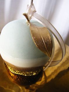 SeaGlass Apple by Connie Cupcake. Layers of white chocolate hand dusted in gold.