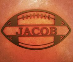 Sports Themed Name Sign- http://www.alabamametalart.com/products/SPORTS-themed-personalized-FOOTBALL-name-sign.php