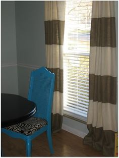 She sewed different burlap stripes together!  Other great burlap curtain ideas on this post!