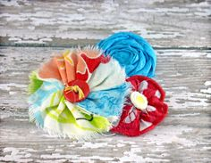 Aqua, Red, Orange Headband, Hair Accessory, Fabric Flower Brooch. $10.50, via Etsy.