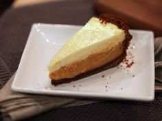 Pumpkin Cream Pie with Gingersnap Crust and Rum Cheesecake Topping recipe from Duff Goldman via Food Network