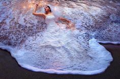 Love the ocean? This image above the perfect photo shoot idea to trash your wedding dress! Lay on the sand, splash in the water and just get soaked in your gown!