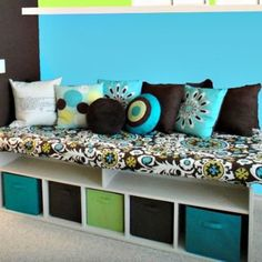 This DIY storage bench with hinged top and upholstered cushion is too cute.