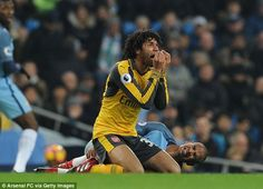 Mohamed Elneny protests his innocence as Arsenal threw away a 1-0 lead at Manchester City