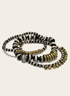 Set of 3 tribal bracelets, strung with paint-striped agate beads and brass rings.