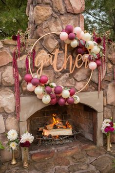 Blush and Bordeaux Balloon Gather Hoop for Friendsgiving. Visit the One Stylish Party blog for ideas + inspiration on ways to style a balloon garland for your next celebration!