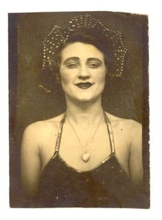 vintage photo booth photo of a circus performer | circa the 1920s