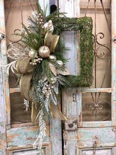 Christmas wreath christmas door decor christmas decor all of our door wreaths door swags are designed with the highest quality in season ribbon and florals market has to offer ▪️base rectangle moss wreath ▪️ribbon d stevens 4 gold ▪️florals platinum fruit Christmas Swags, Christmas Door Decorations, Christmas Frames, Noel Christmas, Christmas Centerpieces, Holiday Wreaths, Rustic Christmas, Christmas Projects, Christmas Ornaments