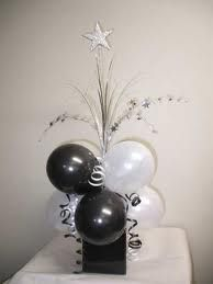 Black and White Balloon Decoration: Cards Against Humanity card(s) on top instead of star.