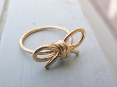 Don't Forget. 14 k gold filled wire bow ring - $35 I would use this as a reminder.....like the idea!  Better than post it notes!