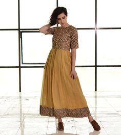 http://kharakapas.com/collections/gypsey-soul/products/mustard-fit-and-flare-button-down-maxi