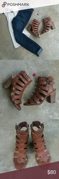 """Vince Camuto Gladiator Sandal Brand new women's size 8 Javrina Gladiator Sandals by Vince Camuto in color cognac. Show some signs of wear while in box that I've pictured as best I could, other than that, they've never hit pavement and are ready for your feet to grace them! Super cute and stylish, with a 3¾"""" heel these would look great with a dress or jeans. Either way, these babies deserve to be shown off! Vince Camuto Shoes Sandals"""