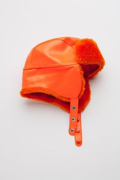SALE Vintage Boho Bright Orange Vinyl & Hunting Cap Trapper EAR WARMER Russian Aviator Glam Hat. $5.00, via Etsy.