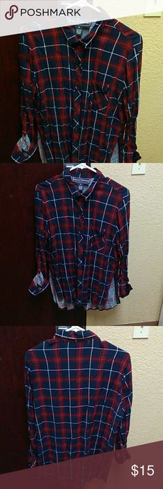Button up Plaid Top Dark blue with Red and White.It can be long sleeves or short sleeves worn only once. 100 percent Rayon.Orginal price 54 Polly & Esther Tops Button Down Shirts
