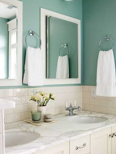 A small space can be just as restorative as a large one -- and color is the main ingredient for setting a peaceful mood. In this bungalow bathroom in Seattle, the mix of materials is limited to two colors: cool blue (which is calming and evokes natural elements) and warm cream (which suggests coziness and comfort). The effect is the visual equivalent of a long, cool drink of water. At the vanity, chrome towel rings, unadorned mirrors, and other minimal accents add to the peaceful mood. (Photo: T