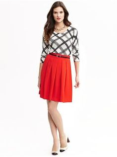 I normally hate red, but maybe a red skirt would work.  There is something very Jessica Day about this outfit.