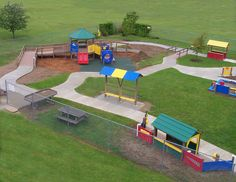 Accessible preschool playground designed by The Adventurous Child, a preschool playground equipment manufacturer dedicated to children and early childhood education through preschool outdoor play. The Adventurous Child specializes in outdoor classrooms, natural playgrounds, and outdoor preschool play equipment featuring environmentally-friendly recycled plastic and natural wood materials.