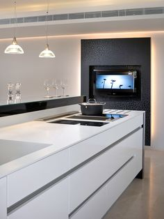 Modern kitchen with big TV screen
