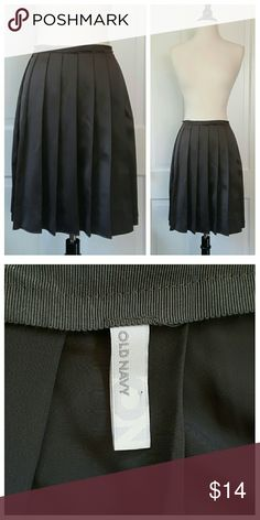 Old Navy Pleated Skirt Old Navy Pleated satin-like skirt. The shine is somewhere between satin shine and lining fabric shine. A darker silvery gray. Old Navy Skirts