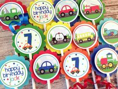 Set of 12 Transportation Cupcake Toppers :  vehicles, cars, trucks, bus, police car and more. $10.00, via Etsy.