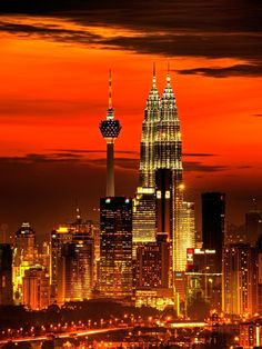 Orange Sunset over Kuala Lumpur.  Reserve a table at the bar on the roof of Trader's Hotel, and watch the sun set behind the Petronas Towers.