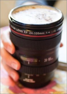 Camera Lens Coffee Cup Thermos - No more boring thermos. This coffee cup is disguised as a camera lens with fantastic attention to detail. Something that will defiantly have your friends intrigued.