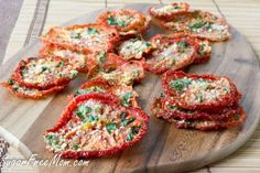 Crispy Parmesan Tomato Chips made in your oven or dehydrator! <em class=short_underline>  </em> Tomato season is upon us where I live and if you happen to have a garden then you know an enormous amount of tomatoes will be upon your counter waiting for you to do something with them. My hubby is the gardener in the family. I don't have a green thumb whatsoever. In fact plants come into my house to die. I've just no luck in water...