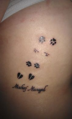 Just realized this is the next tattoo I want. A set of tiger paw prints, giraffe and elephant; for each of my babies.