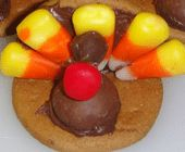 Thanksgiving Turkeys - These Thanksgiving delights require no cooking, are fun to make and before you know it will be gobbled, gobbled, gobbled all up! This simple Thanksgiving recipe is the perfect dessert for kids! Tags: Thanksgiving treats   simple Kid's treats  DIY treats   turkeys   Thanksgiving   candy corn turkeys   Thanksgiving cookies