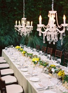 Out door elegant setting for gay wedding at Parker Palm Springs. Decor by Maggie Jensen Florals; photography by Michael Radford, design & planning by Celebrations of Joy.