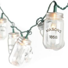 Mason Jar String Lights   Saw them at Ross could be a possible Idea to make the Bride/ Groom Table stand out