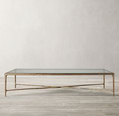 Thaddeus Glass Coffee Table  There are 3 rectangle options that could work.  Look at sizes in space.  The brass is lovely but far more expensive than the forged Iron so see how you think that finish will look in the space.