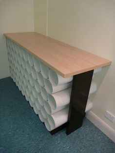 We could build this @ the office for Yoga Friday. Cheap & easy yoga mat storage.