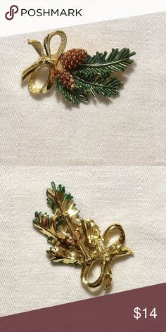 Vintage Gerry's Holiday Pine Bough Swag Brooch Vintage Gerry's holiday pine bough swag brooch is gold toned. The pine bough is green enamel and the pinecones are brown enamel. Excellent condition. Signed Gerry's. Jewelry Brooches