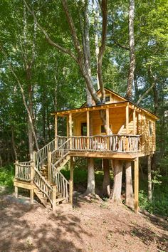 This treehouse comes complete with a front porch and sleeping loft. The railings and banisters were all sourced and built on site. Rubber inner tube and wire ties make the roof water tight at the penetrations and still allow for the trees to grow. Reclaimed windows and doors completed the construction