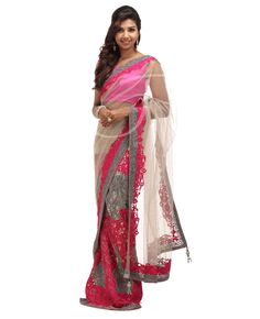 Net Fabric Lacha Saree. Body is Grey net body with stones n saree border, skirt portion is grey net with pink thread work n stones work with border. Border has Pink thread n stones work. Pallu is Grey net with stones n saree border. Blouse has stone work as well as pink thread work on sleeves n back portion of the blouse.