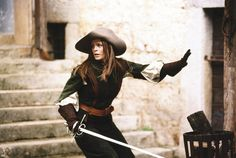 Lady musketeer. Note the doubled-over sleeves and long gloves.