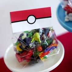 pokemon favor toppers with candy and pokemon figures for the perfect favor