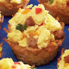 SCRAMBLED EGG NESTS         1 (3 1/2-cup) bag frozen shredded potatoes, defrosted (we used Simply Potatoes)          1/3 cup vegetable oil or butter          1/2 teaspoon salt          1/4 teaspoon pepper          6 eggs            2/3 cup milk          1/2 cup finely diced onions          1/3 cup finely diced bell peppers          3/4 cup diced cooked breakfast sausage Shredded Cheddar          Chopped parsley for garnish (optional)