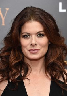Debra Messing Long Curls - Debra Messing looked flirty-chic with her thick, bouncy curls at the New York premiere of 'Cafe Society.'