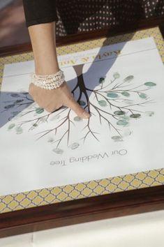 Wedding tree guest book ideas. Photo via Style Me Pretty
