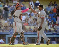LOS ANGELES, CA - MAY 11: Hector Sanchez #29 of the San Francisco Giants celebrates a 7-4 win over the Los Angeles Dodgers with Jean Machi #63 at Dodger Stadium on May 11, 2014 in Los Angeles, California. (Photo by Harry How/Getty Images)