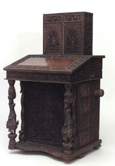 Antique Oriental Burmese style (19th Cent) carved walnut captains desk with side drawers and slant top. $7,250