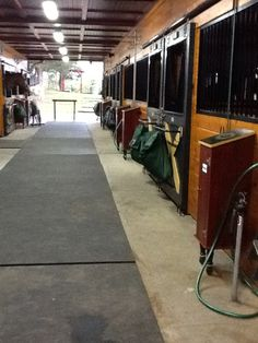 Barn aisle with built-in tack trunks.    Roseview Dressage, Millbrook, NY.