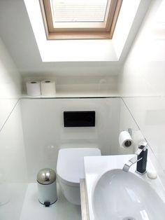 Roof windows solve the eteranl problem of tiny loft conversion bathrooms - they flood the area with light and create an illusion of space.