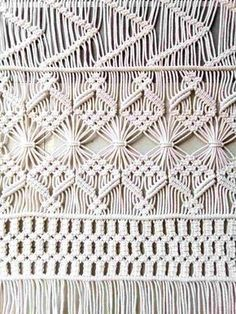 This gorgeous handmade macrame wall hanging is made with 5mm neutral cotton macrame cord. With this macrame wall hanging youll instantly add a bohemian vibe to your room an it will really warm up a space. Let me create something special for you! You're always welcome to contact me
