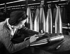 Woman working on ordnance, General Motors Corp., Pontiac, MI - Date: ca. 1941-1945 (Rights: Please cite Southern Methodist University, Central University Libraries, DeGolyer Library when using this image file.)